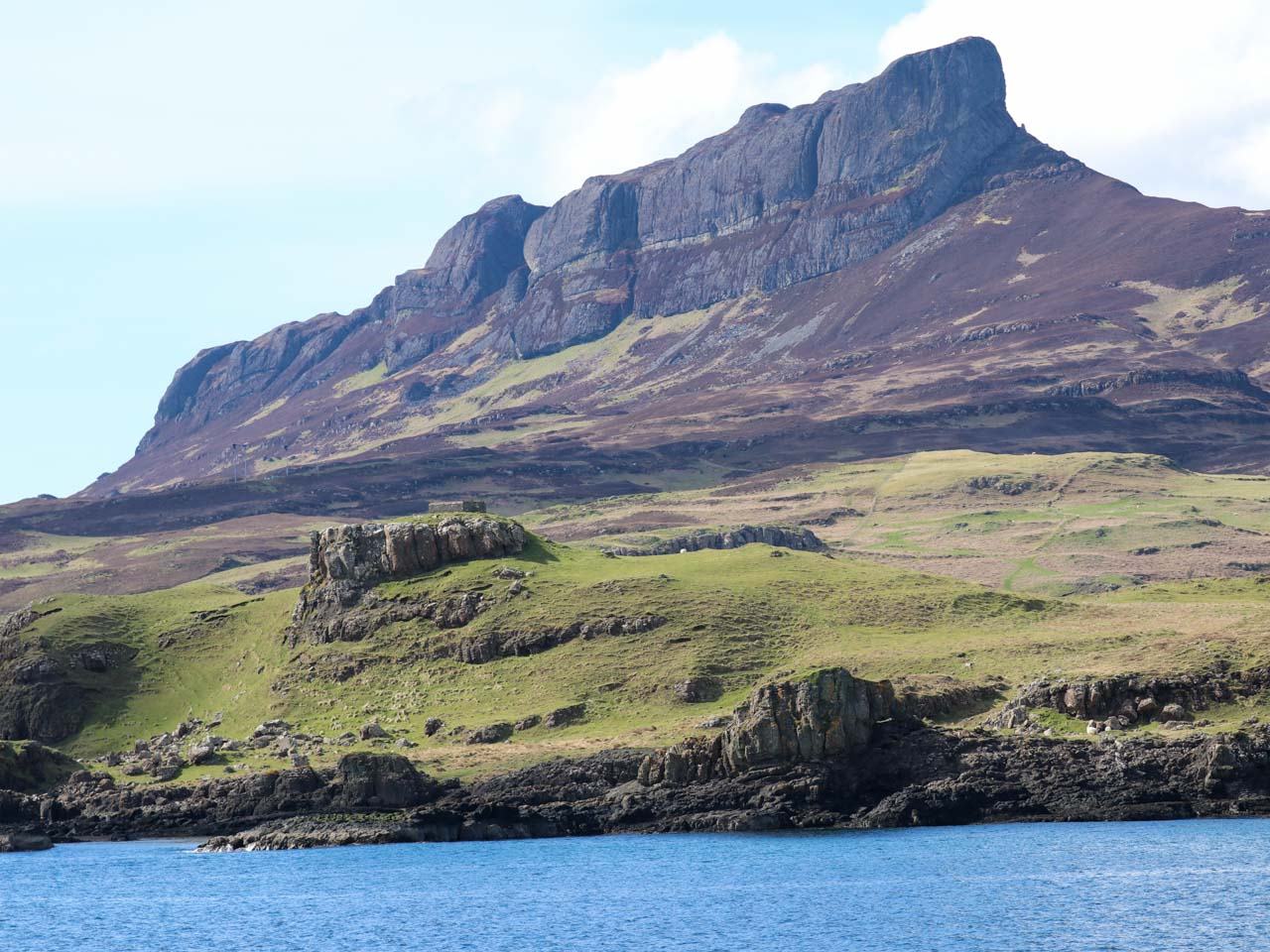 Profile of volcanic An Sgurr on Isle of Eigg, Small Isles, Hebrides, as seen from the ocean