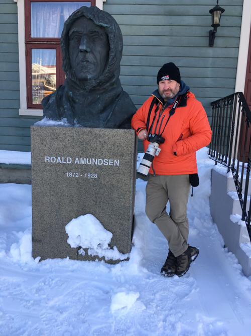 Andy Gilbert beside Roald Amundsen bust outside the Polar Museum in Tromso, Norway