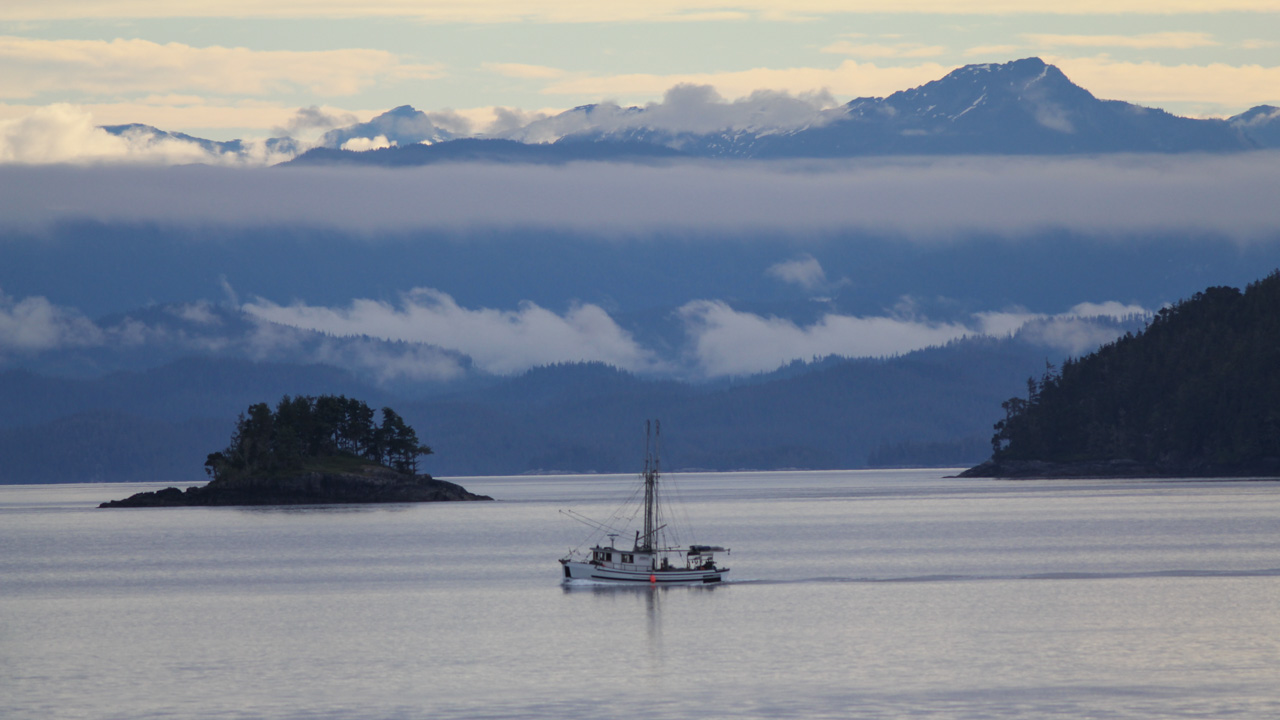 Misty mountains and islands plus fishing boat. Broughton Archipelago looking from Telegraph Cove