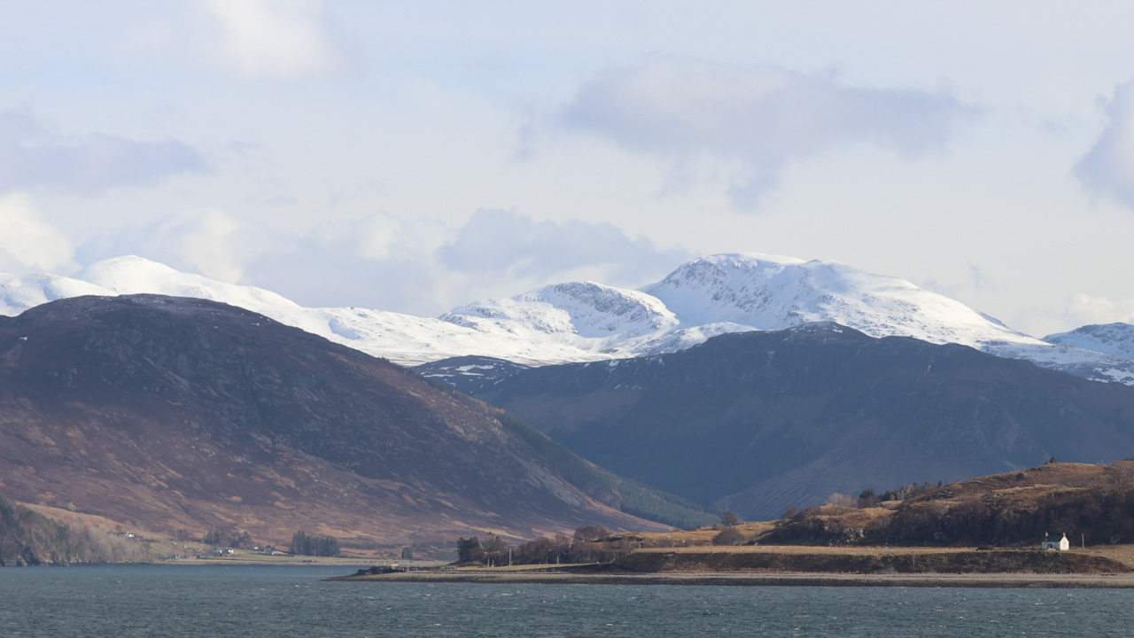 Snow covered peaks at the end of Loch Broom, Wester Ross, Scotland